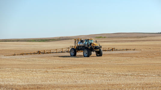 Decorative image of sprayer tractor spraying a clean field